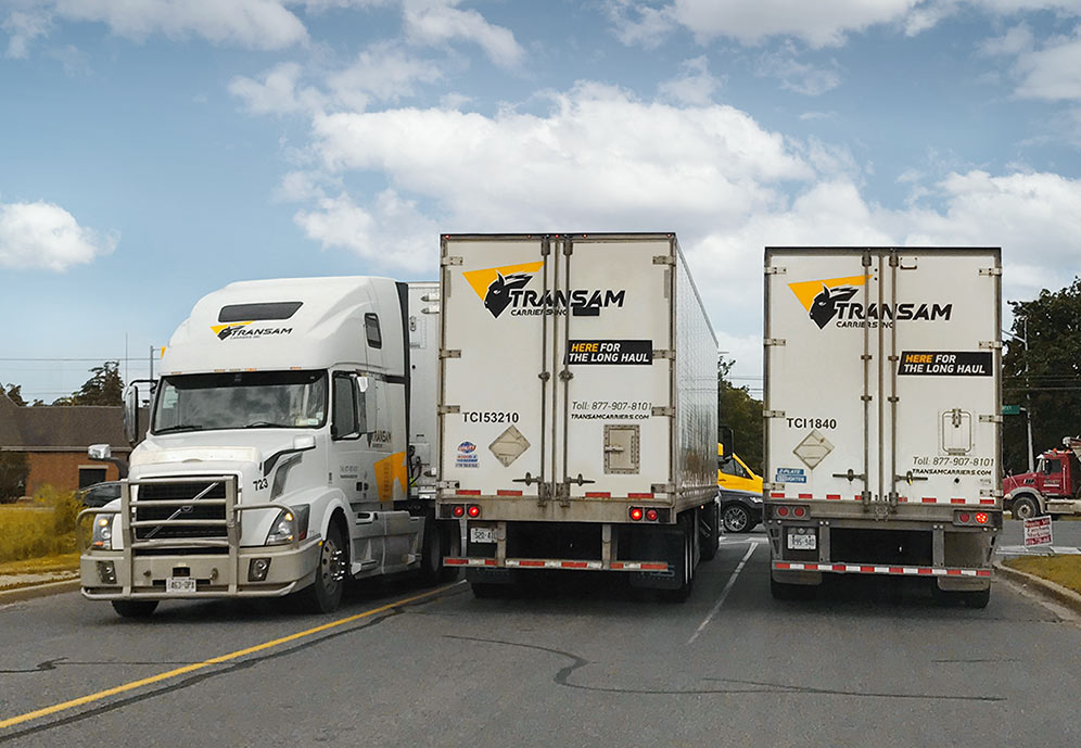 Transam Carriers' trucks on the road